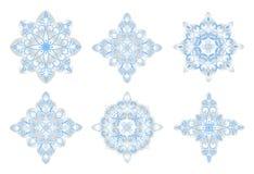 Bożenarodzeniowa sztuka. Na biały tle błękitny płatek śniegu Fotografia Royalty Free