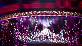 Bożenarodzeniowe oświetleniowe bokeh dekoracji purpury zdjęcia royalty free