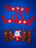 Bożenarodzeniowe zabawki Santa i renifer z słowo Szczęśliwym wakacje Zdjęcia Royalty Free