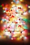 Bożenarodzeniowego nowego roku pojęcia drzewna instalacja Zdjęcie Stock
