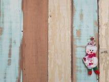 Bożenarodzeniowej dekoraci śliczny przedmiot z drewnianym tłem Obrazy Royalty Free