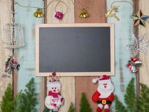 Bożenarodzeniowej dekoraci śliczny przedmiot z drewnianym tłem Zdjęcia Stock