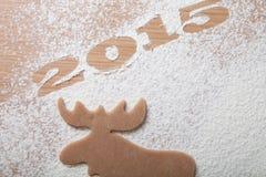 Bożenarodzeniowi domowej roboty ciastka w postaci łosia z inscriptio Obraz Royalty Free