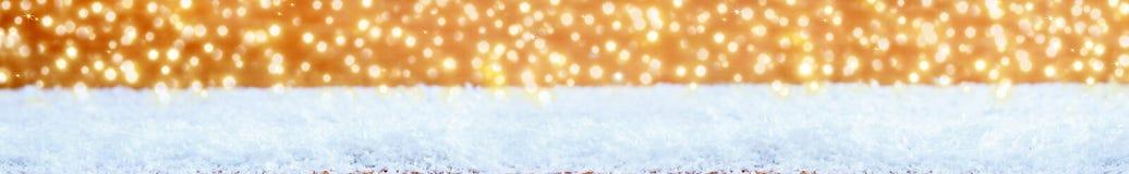 Bożenarodzeniowy śnieżny tło i świecący światła zdjęcie royalty free