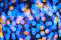 Bożenarodzeniowy błękitny kółkowy bokeh tło Fotografia Stock