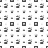 Bożenarodzeniowy bezszwowy wzór z prezentami i gwiazdami na białym tle Obrazy Stock