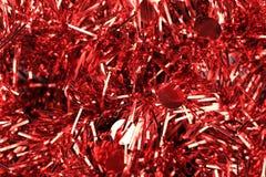 Bożenarodzeniowy czerwony świecidełko z gwiazdami. Obrazy Royalty Free
