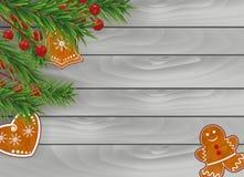 Bożenarodzeniowy drewniany szary tło z Piernikowymi ciastkami, choinek gałąź i Uświęconymi jagodami dla projekta, Xmas i nowego r royalty ilustracja