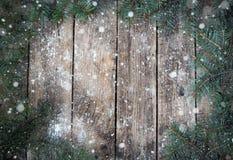 Bożenarodzeniowy drewniany tło z gałąź choinka i śnieg piękne święta ilustracji projektu wektora Zdjęcia Stock