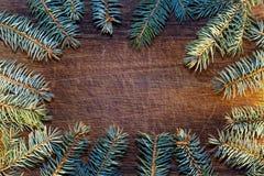 Bożenarodzeniowy drewniany tło z jedlinowym drzewem Zdjęcie Stock
