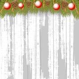 Bożenarodzeniowy drewniany tło z jedlinowym gałąź sosny rożkiem i czerwienią Zdjęcie Royalty Free