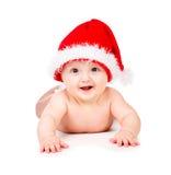 Bożenarodzeniowy dziecko w Święty Mikołaj kapeluszu fotografia stock