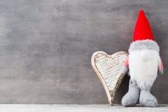 Bożenarodzeniowy gnomu und Santa kapelusz Boże Narodzenie wzór Tło dalej Obrazy Royalty Free