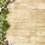 Bożenarodzeniowy jedlinowy drzewo z opadem śniegu na drewnianej desce Obrazy Royalty Free