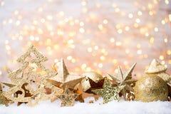 Bożenarodzeniowy kartka z pozdrowieniami z bożego narodzenia złota dekoracjami Obrazy Stock