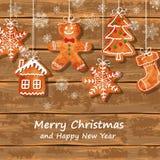 Bożenarodzeniowy kartka z pozdrowieniami z piernikowymi ciastkami Zdjęcia Stock