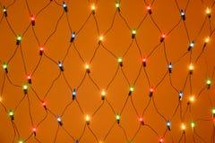 Bożenarodzeniowy kolorowy girlandy fishnet tło Fotografia Royalty Free