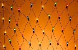 Bożenarodzeniowy kolorowy girlandy fishnet tło Zdjęcie Royalty Free