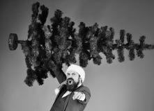 Bożenarodzeniowy korporacyjny partyjny pojęcie Mężczyzna w kostiumu i Santa kapeluszu zdjęcie stock