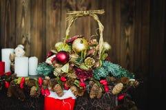 Bożenarodzeniowy kosza i świeczki zbliżenie Fotografia Stock