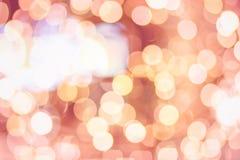 Bożenarodzeniowy nowego roku bokeh tło Zamazany światło w ciepłym brzmienia tle Sklepu centrum handlowego sklepowy pojęcie miękki Obraz Stock