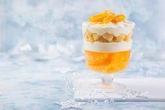 Bożenarodzeniowy pomarańczowy karabin Świąteczny płatowaty deser obrazy stock