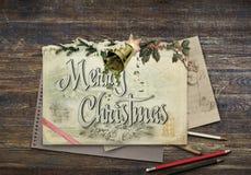 Bożenarodzeniowy rysunek na pustego rocznika brązu drewnianym stole, closeu zdjęcia royalty free