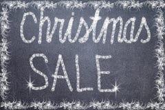 Bożenarodzeniowy sprzedaż tekst pisać na chalkboard Obraz Stock