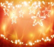 Bożenarodzeniowy tło skupiający się światła z dekorować Szklanymi gwiazdami Zdjęcia Royalty Free