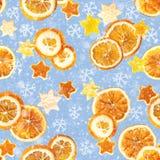 Bożenarodzeniowy tło wysuszone pomarańcze, łupa w formie gwiazdy z cynamonem i Bezszwowy tło zdjęcie royalty free