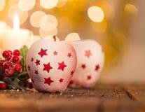 Bożenarodzeniowy tło z czerwonymi jabłkami Fotografia Stock