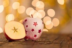 Bożenarodzeniowy tło z czerwonymi jabłkami Fotografia Royalty Free