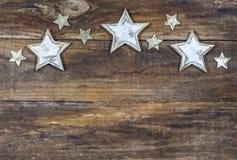 Bożenarodzeniowy tło z drewnianą gwiazdy granicą Zdjęcie Stock
