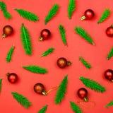 Bożenarodzeniowy tło z gałąź i dekoracjami na czerwieni Fotografia Stock