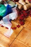 Bożenarodzeniowy tło z kolorowymi dekoracjami, piłką i zabawką, Fotografia Stock