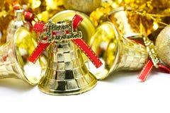 Bożenarodzeniowy tło z złotego dzwonu ornamentem Obraz Stock