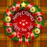 Bożenarodzeniowy wianek na dębnym szkockiej kraty tle Obraz Royalty Free