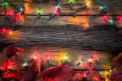 Bożonarodzeniowe światła obramiają tło Fotografia Stock