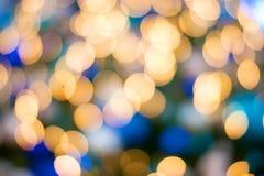 Bożonarodzeniowe światła złoci i błękitny bokeh Zdjęcie Royalty Free