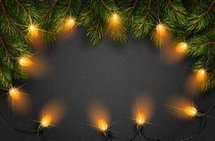 Bożonarodzeniowe światła z jedlinowymi gałąź Obrazy Royalty Free