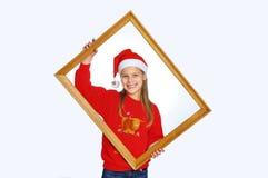 bożych narodzeń dziewczyny kapelusze czerwoni Zdjęcia Stock