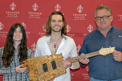 Bo Bice. April 08, 2011, Sacramento, CA - Bo Bice poses with custom guitar. Pictured Brittany Brazil, Bo Bice, and Duane Calkins at Thunder Valley Casino in Royalty Free Stock Photo