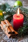 Boże Narodzenia candle i cynamon Fotografia Stock