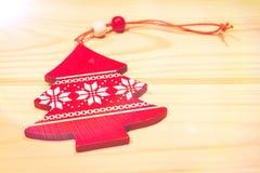 Bożenarodzeniowa drewniana ornament zabawka z faborkiem Zdjęcie Stock