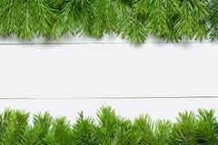 Bożenarodzeniowa jedlinowego drzewa rama na drewnianej desce Fotografia Royalty Free