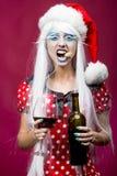 Bożenarodzeniowa kobieta z winem Obraz Royalty Free