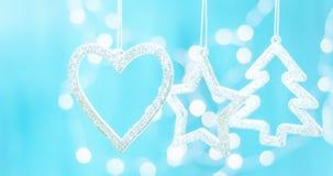 Bo?enarodzeniowe dekoracje, serce, choinka, gwiazda, Za?wiecaj? na b?yskotliwo?ci tle obrazy stock