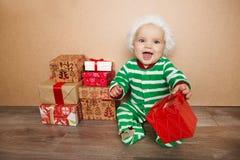 Bożenarodzeniowy dziecko w Santa kapeluszu Obrazy Royalty Free