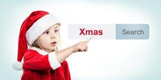 Bożenarodzeniowy dziecko w Santa kapeluszu z WWW adresu barem Zdjęcia Stock