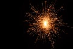Bożenarodzeniowy i newyear partyjny sparkler na czerni Zdjęcia Royalty Free